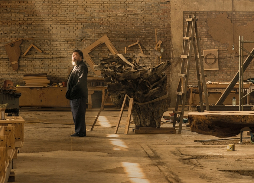 Ai Weiwei in his studio in Beijing, taken in April 2015 . Photo (c) Harry Pearce/Pentagram, 2015.