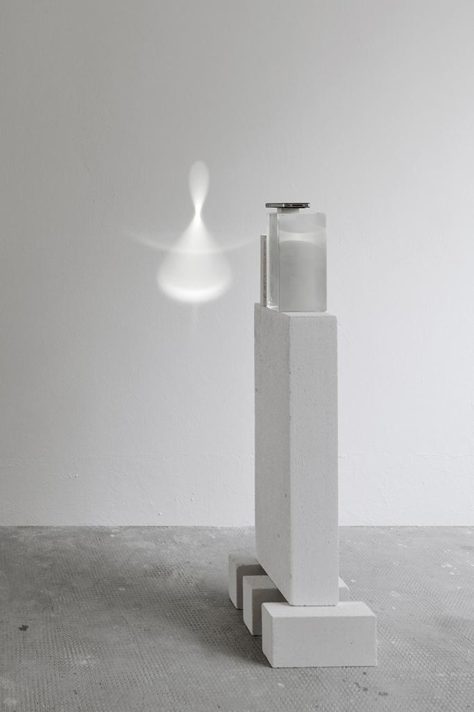 Parabolic mirror - Test 5, 2016 Aluminium, glass, iPhone, crystal glass, travertine, fire-resistant bricks, pencil Courtesy Formafantasma